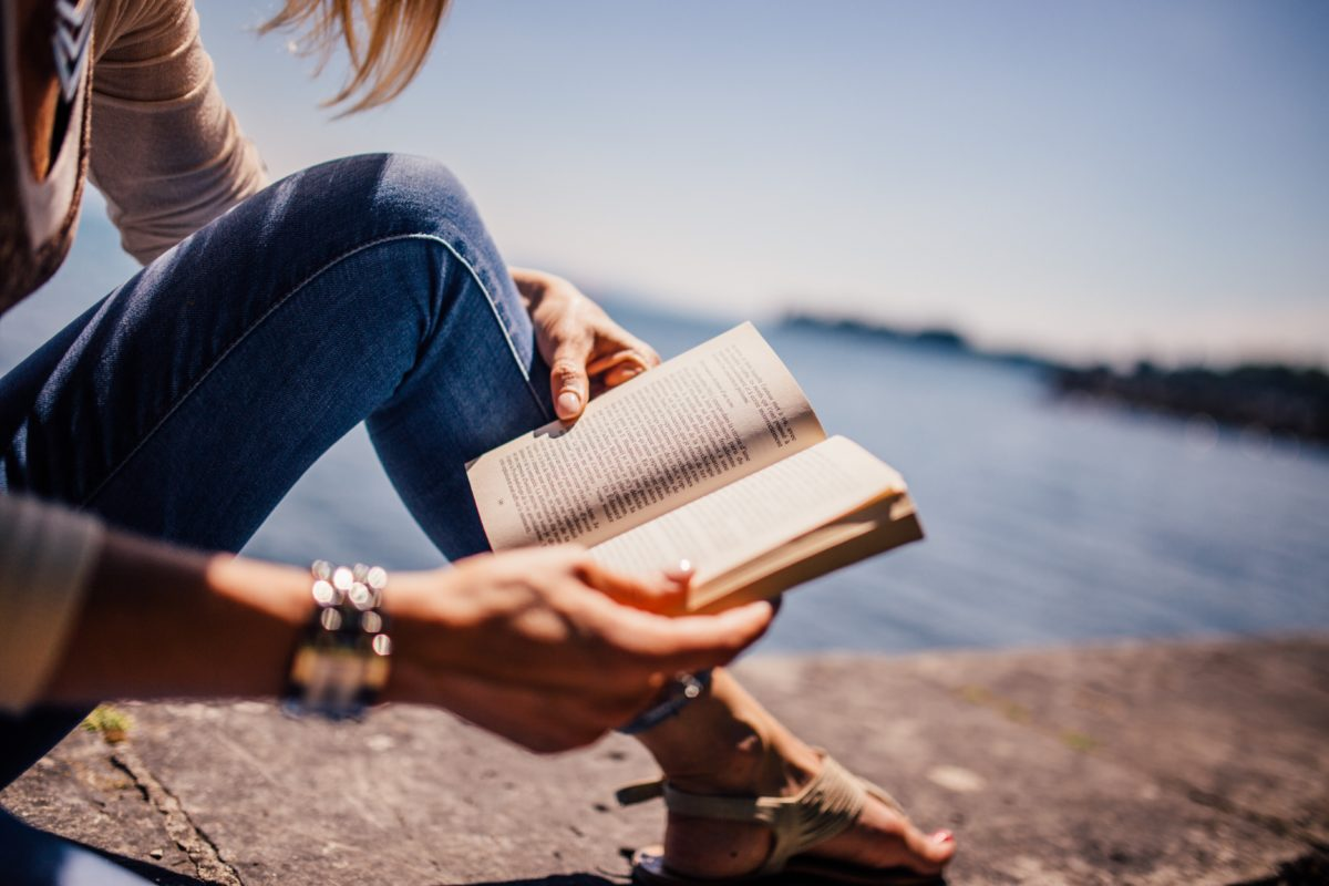 lake view, girl reads from book